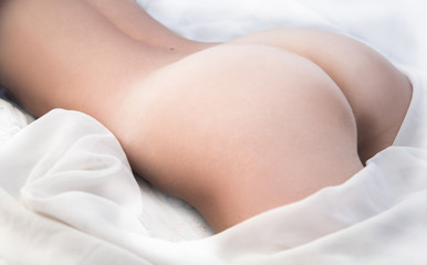 Naked woman buttocks with white bacground