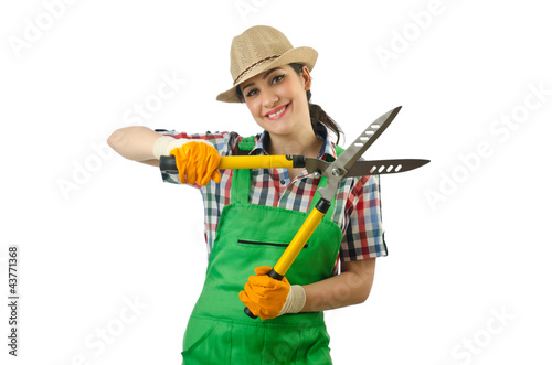 Girl with garden scissors on white