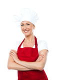 Middle aged female chef posing with crossed arms