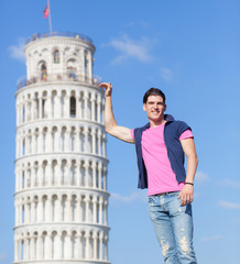 Young Man Posing with Leaning Tower in Pisa