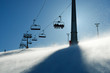backlit scenes with ski lift chairs