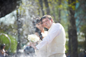 Happy bride and groom with bouquet