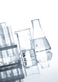 Glass flasks with a clear liquid, isolated
