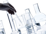 Set of glass flasks with a clear liquid, isolated