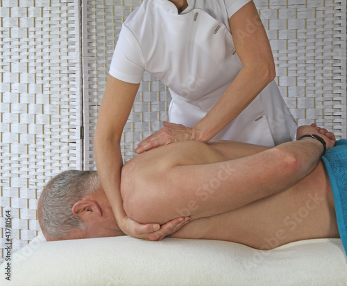 Therapist performing a lift and stretch