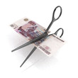 scissors cutting ruble notes