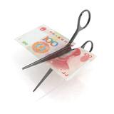 scissors cutting yuan notes