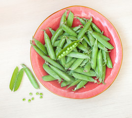 Peas pods on a plate top view