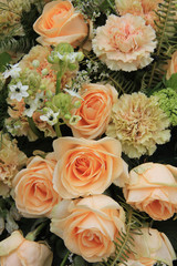 Carnations and roses in pale orange
