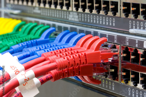 Leinwanddruck Bild Network switch and UTP ethernet cables
