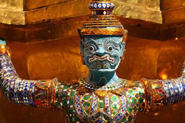 Demon statue guarding at the Grand Palace in Bangkok, Thailand