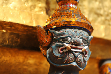 Guardian spirit with golden headdress at Grand palace, Bangkok