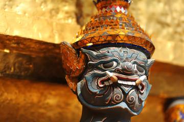 Guardian spirit with golden headdress at Grand palace, Bangkok