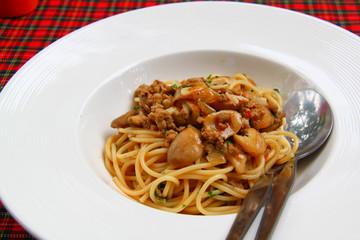 Spaghetti pork with  mushrooms and gravy sauce