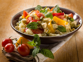 vegetarian couscous with tofu capsicum mint and capers