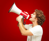 Portrait Of Young Man Shouting With A Megaphone