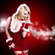attraktive Weihnachtsfrau vor Lichterhintergrund