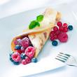 Berry pancake sprinkled with sugar