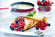 Panfried golden pancake with berries
