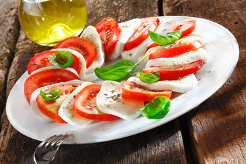 Colourful slices of cheese and tomato