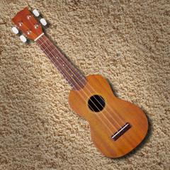 ukulele on sand texture