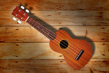 ukulele on Old wood wall texture background