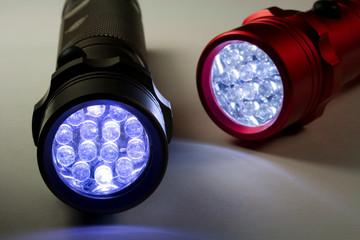 Two Modern LED Flashlights - Turned On