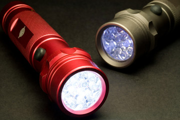Two Modern LED Flashlights - Turned On
