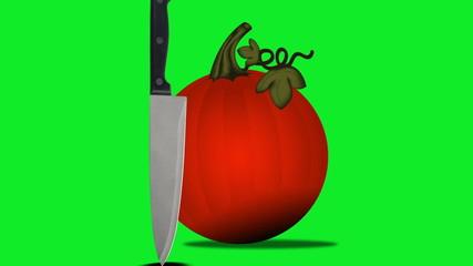 A knife meets a pumpkin on a green screen.