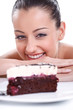 Happy woman looking in tasty cakes