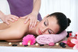 Woman in a day spa getting a deep tissue massage