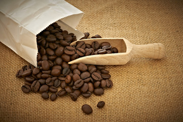 Heap of coffee beans and shovel