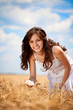 Smiling woman in wheat field