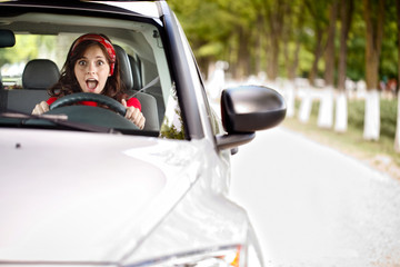 scared woman behind the wheel