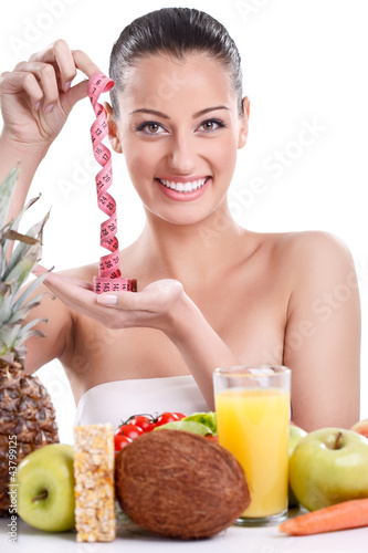 Woman with healthy food and measuring tape