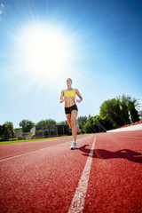 Runner on athletic track