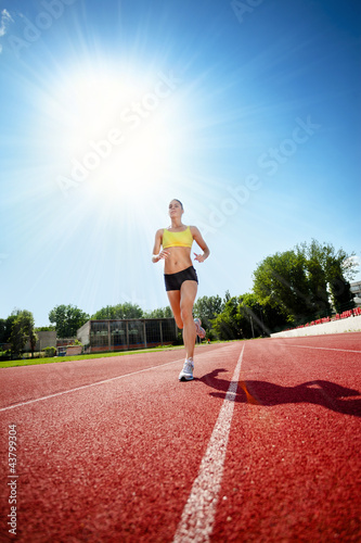 Runner on athletic track