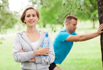 Couple Exercising In Park