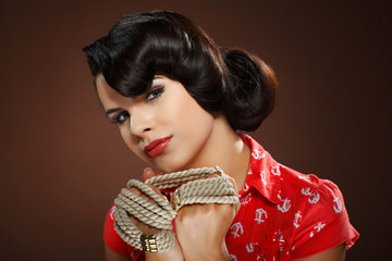 A photo of beautiful brunette is in style of pinup, glamur