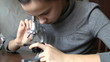Teenage girl using microscope close-up
