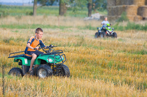 Boy riding a quad bike