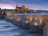 Roman bridge at sunset in Cordoba, Spain