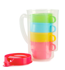 Four colorful cups with pitcher