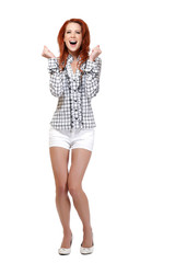 excited redhead woman posing on white background