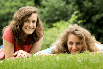 Teens lying in a grass