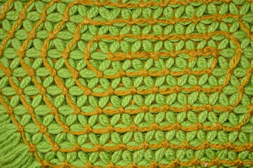 Green and orange loom work