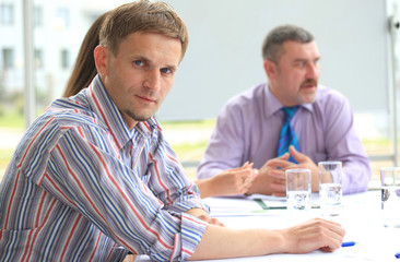 young business man attending a meeting with his colleagues