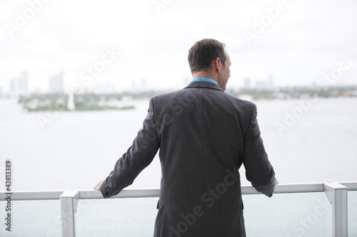 Businessman looking over the balcony