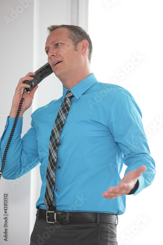 Businessman arguing on the phone