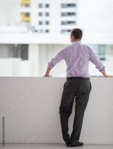 Businessman looking at the city